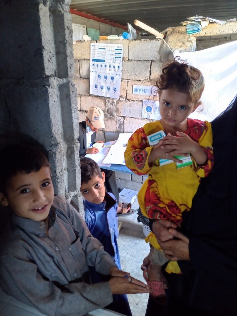 A patient girl receives health checkup and medicine